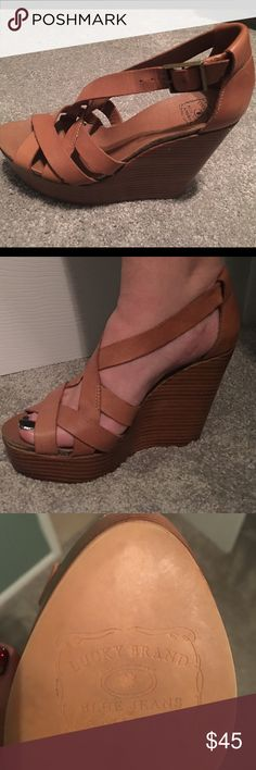 Lucky brand wedges, 10's Brown lucky brand cross wedges with wooden stacked heels. Heel is high, 5 inches. Size 10. Worn several times, still in great condition. Flexible on price. Lucky Brand Shoes Espadrilles