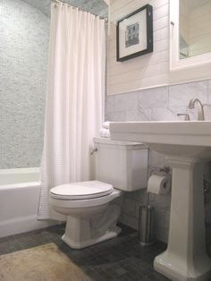 Toilet paper holder placement J: square toilet + square sink + white curtain + tile