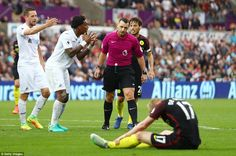 Leroy Fer of Swansea City argues with Niel Swarbrick after he awarded a penalty after a fo...