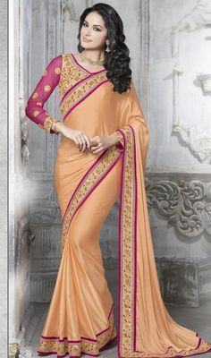 Make an adorable statement in this papayawhip color embroidered net and satin sari. The lace, resham and stones work on dress personifies entire appearance. #netsarees #satinsari #embrooideredcasualsaree