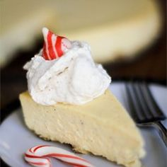 Eggnog Cheesecake III - in batter, use total of 1 C eggnog, total of 2 T of rum extract, add 1 t cinnamon, add half t nutmeg. In crust, add half t cinnamon, and quarter t of nutmeg. Double the crust (optional). Beat the cream cheese and sugar for 3 minutes before adding other ingredients.