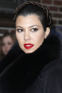 For a new take on the messy milkmaid braid, try a high-shine twist paired with patent red lipstick.   - HarpersBAZAAR.com