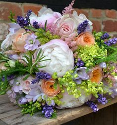 Bridal bouquet of pale pink peony, vuvuzela roses, peach lisianthus, cream spring roses, lavender, pale pink stock, lilac freesia and ivy, achillea mollis - Bury Court Barn