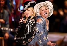 """[Watch] Miley Cyrus On MTV Unplugged; Brings Out Madonna - http://getmybuzzup.com/wp-content/uploads/2014/01/miley-cyrus-madonna-unplugged-2.jpg- http://getmybuzzup.com/miley-cyrus-on-mtv-unplugged/- Miley Cyrus On MTV Unplugged ByAmber B Miley Cyrus hit the stage yesterday for a live performance on MTV's Unplugged. She performed several of her hits including """"Wrecking Ball,"""" and a very special duet melody with Madonna """"Don't Tell Me/We Can&#82"""