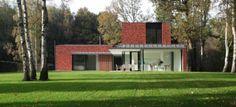 Huis in Heffen - achteraanzicht ; grote glaspartijen op het gelijkvloers