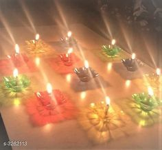 Festive Diyas & Candles Designer Plastic Candles Diya For Diwali   *Material* Wax  *Size* Free Size Multicolor Reflection Diya - Set of 12 Diyas  (Assorted Designs) * 12 Hard Plastic Diyas available in multi colours - Red, Light Green, Orange, Blue, Purple * 12 Wick Holder - To be attached to Diya * 12 Cotton Wicks - To be inserted inside the clip  *Transparent Plastic Box - All the contents of this set are packed in this transparent Plastic Box which is reusable to store diyas.  *Description* It Has 12 Pieces Of Diyas  *Sizes Available* Free Size *   Catalog Rating: ★4.3 (1193)  Catalog Name: Decorative Designer Plastic Candles Diya For Diwali Vol 1 CatalogID_450292 C128-SC1604 Code: 402-3262113-