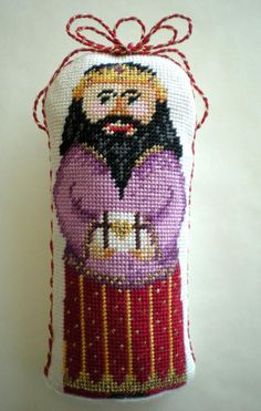 Learn how to turn any stitched needlepoint piece into a stand-up figure with these simple steps. Get directions for making a weighted base with cord.