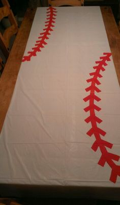 Baseball party table cloth from the Dollar Store that I painted baseball stitching on