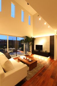 living room with atrium and spot lights
