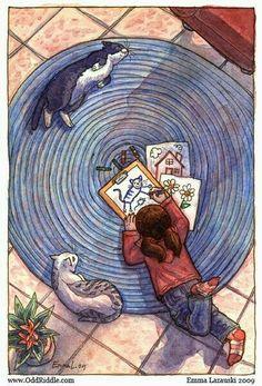 bimba disegna i suoi gatti sul tappeto