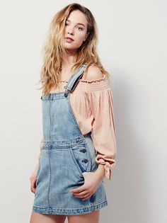 Me & You Jumper | Denim cotton skirt jumper featuring adjustable straps. Four-pocket style with button sides.