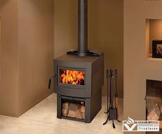 Fusion Wood Stove by Pacific Energy from Vancouver Gas Fireplaces.  Bigger than its European cousins, The Fusion delivers easier loading, clean, efficient heat and longer burn times with Pacific Energy's proven Hi-Tech firebox. Standing taller than most wood stoves, The Fusion gives you more view of the fire through its low-glare glass. The innovative design includes a wood storage chamber. The Fusion is complemented by a Stainless Steel or Metallic Black finish.