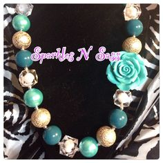 A personal favorite from my Etsy shop https://www.etsy.com/listing/236354023/aqua-and-gold-chunky-bead-necklace