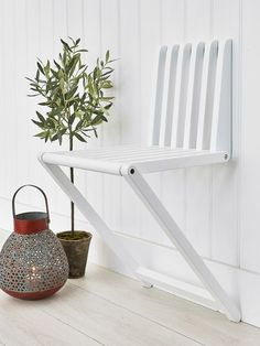 This cleverly designed wooden wall chair will become an invaluable piece in any small space or hallway!