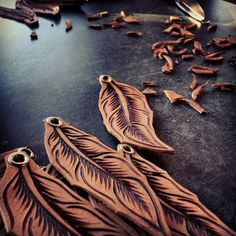 Freehand Burned Leather Feather Keychain on Etsy, $26.00. I haven't tried Leather as yet but I really must give it a go. These look really good ;)
