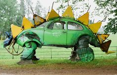 car parts art  Dinosaur Beetle A 'Mutoid Waste Co' sculpture from the Beautiful Days festival in Devon, UK. Flickr photo by Mark Massey.