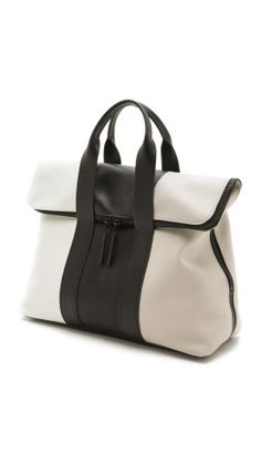 A spacious fold-over 3.1 Phillip Lim bag in rich tri-tone leather. Double handles offer easy transport, and the wraparound zip top opens to an unlined interior with a single zip pocket. Dust bag included.Leather: Cowhide.Weight: 40oz / 1.13kg.Imported, China.MEASUREMENTSHeight: 14in / 35.5cmLength: 17in / 43cmDepth: 7in / 18cmStrap drop: 3in / 7.5cm