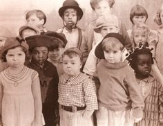 The Original Our GangIn the front row Mary, Pinapple, Spanky, Scottie, and Farina. Stymie is in the back row with the hat on . I don't know who the others are.