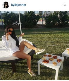 Kylie Jenner in her Gold Nike Airmax Liquids - limited edition