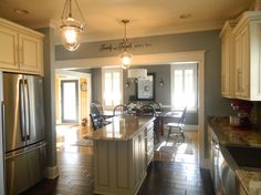 My newly remodeled kitchen,  We totally gutted the kitchen, We took down the wall between the dining room and kitchen to open the space up. ... like this color of the kitchen