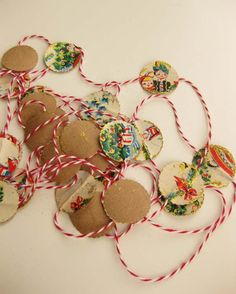 paper garland made from vintage Christmas wrap, twine, kraft paper, and a little glitter