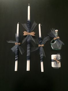 Perfect for any little gentleman being baptized!! The set is decorated with light blue and navy tulle and a bow ties Set includes: 1 - 24 inch candle 2 - 17 inch candles 1 - bar of soap 1 - oil container (oil not included)