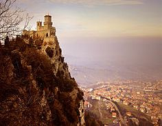 Photo of Guaita.  The Three Towers of San Marino are located on the three peaks of Monte Titano in the capital. They are depicted on both the Flag of San Marino and its coat of arms. The three towers are: Guaita, the oldest of the three (it was constructed in the 11th century); the thirteenth-century Cesta, located on the highest of Monte Titano's summits; and the fourteenth-century Montale, on the smallest of Monte Titano's summits, still privately owned.