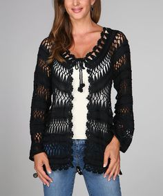 Lightly fastening at the bust with a dainty tie, this cotton cardi flaunts intricate crochet work and an airy, open design.