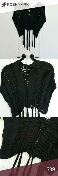 "Braided Scissor Cutout Fringe Top Braided and scissor cut out top with fringe ends. Bat wing sleeves.    Measurements Laying Flat - Approx.  Length to the longest end - 19"" Pit-to-pit - 17""  94% Cotton, 6% spandex   Boutique brand. NWOT. ■  PRICE IS FIRM  ■ Tops Crop Tops"