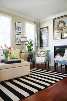 living room with striped rug