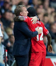 Victor Moses embraces Manager Brendan Rodgers after he made it 2-1 to #LFC