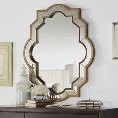 The Cortland mirror is a traditional piece bordered with an antique gold leaf…