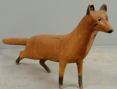 """Sold For $ 4000                                              Carved wood standing fox with glass eyes and original paint decoration, 19thc. 21""""h.x45""""l.                            Condition report           A patch loose on his chest, but is present- As found condition- see photos. Any condition statement is given as a courtesy to a client, is only an opinion and should not be treated as a statement of fact. Wiederseim Associates, Inc. Auctioneers shall have no responsibility for any e"""