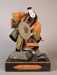 "Takeda-ningyô holding a jingasa helmet, Edo Period, 19th Century, 15"" High"