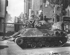 This was donated to the museum with the following note.. This is the first tank crew of the 41st Tank Battalion, 11th Armored Division, 3rd US Army to reach the Rhine in the breakthrough. Crew members Cpl. William Hanse, Private Marvin Aldridge, T/4 John Latimi, Cpl. Vincent Merreale and Cpl. Sidney Mayer, 21 March 1945. M4A3E8 Sherman tank, up armored.