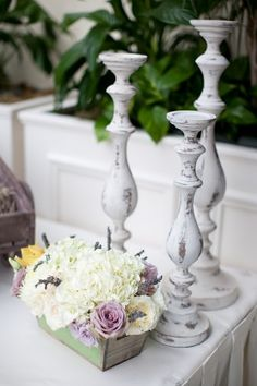 Have seen similar plain wood candlesticks at Michael's. Paint with white eggshell paint. Scuff up with a sanding sponge. Stain with a charcoal gray paint and then seal.