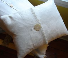 Ideas and Uses for Vintage Linens-this: a pillow made from damaged damask linen tablecloth.