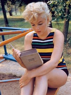 "Marilyn Monroe has almost finished ""Ulysses"" by James Joyce in this pic."