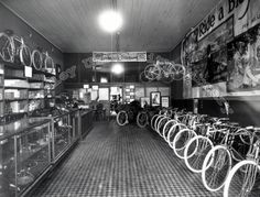 Voss Brothers' Bicycle Shop in Peoria, IL. Motorcycles are in the back of the store with the bicycles in front. Peoria Illinois, Bicycle Shop, Vintage Bicycles, Professional Photography, Great Pictures, Brother, America, History, Rivers