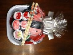 Such a cute idea! Use baby items to roll up and make a sushi plate.