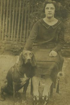 Vintage real photo postcard of woman with her dog.
