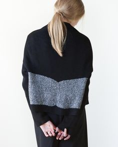 Stark contrast of marled and solid colors in this blocked cardigan are juxtaposed against soft curves of the draped fabric. All while two different aspects of color blocking are presented whether s...