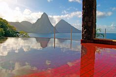 Located in the eastern Caribbean Sea, Jade Mountain in St. Lucia is one of the most incredible resorts the Sifter has seen. Each room has only three walls and a private infinity pool with stunning panoramic views of the beautiful Caribbean. Jade Mountain St Lucia, St Lucia Resorts, Hotels And Resorts, Dream Vacations, Vacation Spots, Caribbean Resort, Caribbean Sea, Western Caribbean, Paradise On Earth