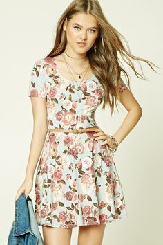 Style Deals - A stretch knit mini dress featuring an allover floral print, a scoop neckline, short sleeves, a flared skirt, and a faux leather belt.