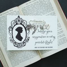 This quirky brooch is presented on a postcard with an illustration and quote from Jane Austen's famous story, Pride and Prejudice.  This brooch is a fun gift for anyone who is a fan of the story or a book lover in general. This would make a thoughtful gift for a birthday or as a stock...
