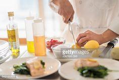 Stock Photo : Korean chef slicing lemons in kitchen