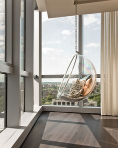 Terrat Elms Interior Design. The hanging bubble chair is the perfect place to relax and grab a book. http://manhattanhomedesign.com/bubble-chair.html#.UbI8p_ZAQ8k