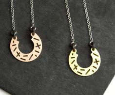 Necklace, horseshoe shape, brass, bronze, silver. Cut out lines, random pattern. Camillette Jewelry | camillette.com