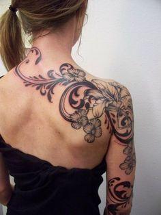 love.....beautiful flowers, swirls, filigree tat on shoulder and down arm