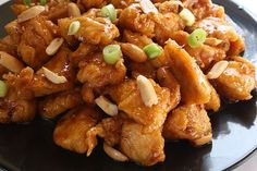 A buffet's worth of yummy Chinese recipes on one page!  Includes Sesame Chicken, Orange Chicken, Kung Pao Chicken, Chicken Skewers, Crab Rangoons, Egg Rolls, Garlic Green Beans, Fried Rice, Egg Drop Soup, and Doughnuts.